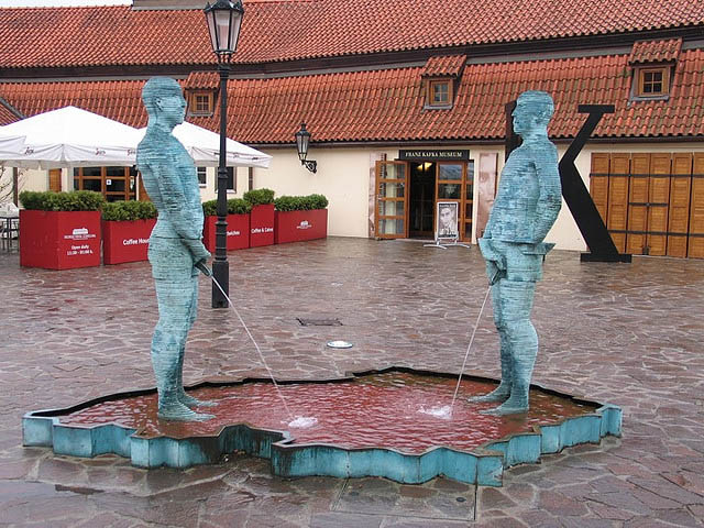 Statues of two men who urinate