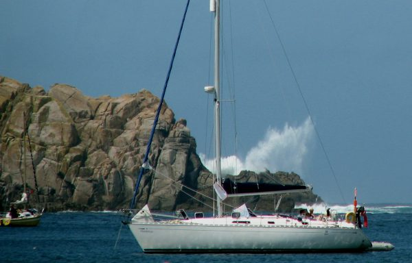The yacht anchored in New Grimsby is less than 300 metres from the violent wave, but is in calm water