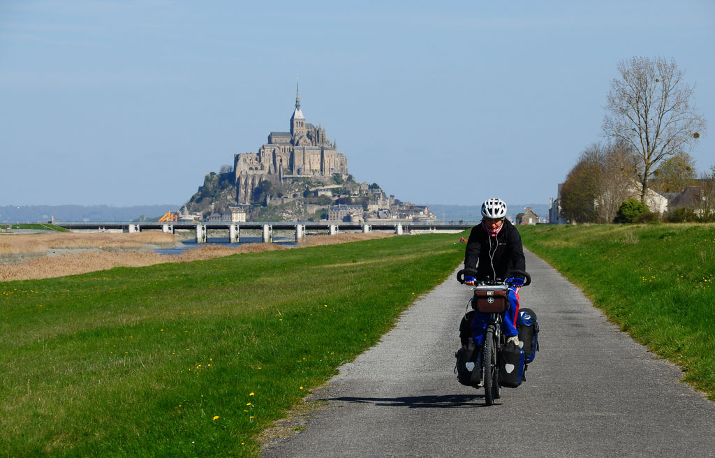 Cycling in Normandy. On the Background is the Mont Saint Michel.